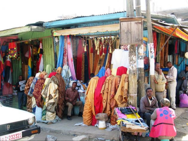 Fabric shops in the Mercato, the largest covered market in Africa
