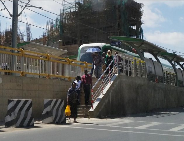 Passengers at a tram stop in Addis Ababa
